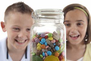 Girl & boy looking at sweet jar