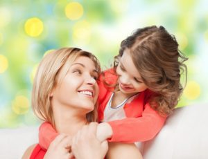 mother with daughter hugging and talking