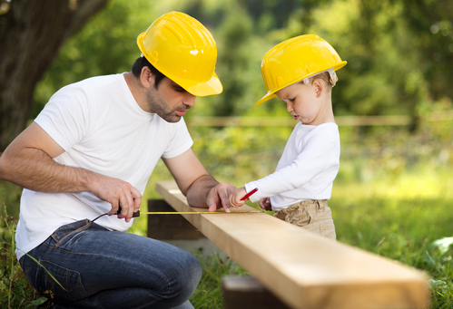 father and son building