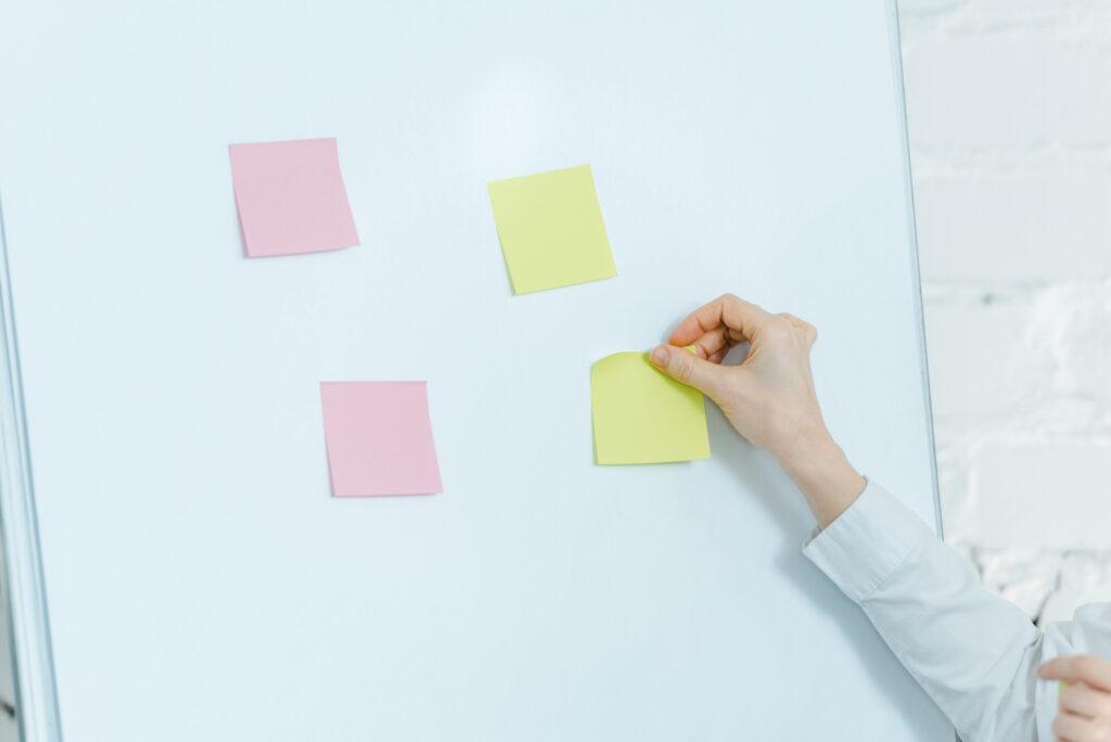 4 sticky notes on whiteboard