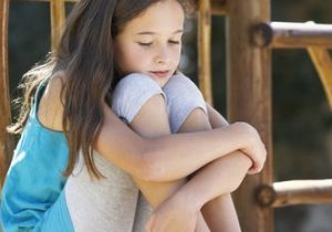 girl-hugging-legs-